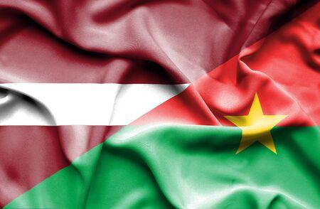 burkina faso: Waving flag of Burkina Faso and Latvia