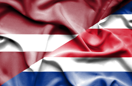 latvia: Waving flag of Costa Rica and Latvia