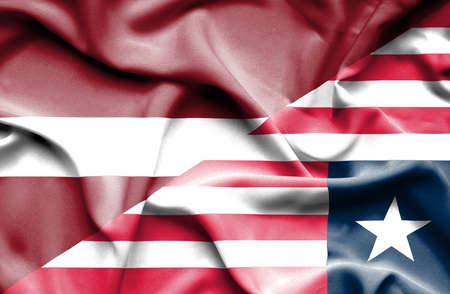 latvia: Waving flag of Liberia and Latvia Stock Photo