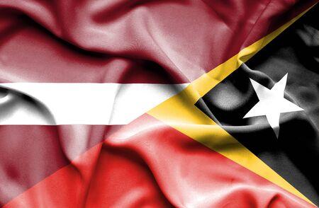 east: Waving flag of East Timor and Latvia