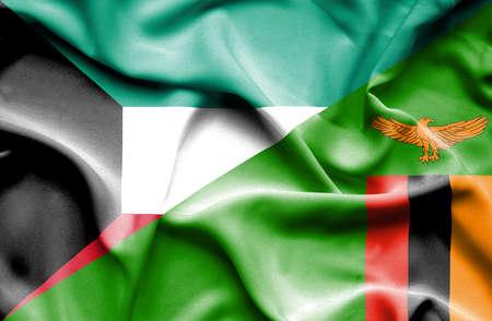 zimbabwe: Ondeando la bandera de Zimbabwe y Kuwait Foto de archivo
