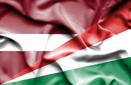 seychelles: Waving flag of Seychelles and Latvia