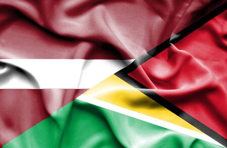 latvia: Waving flag of Guyana and Latvia