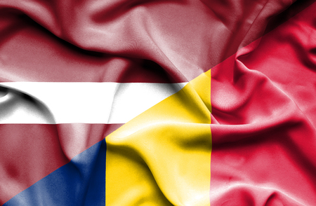 chad: Waving flag of Chad and Latvia Stock Photo