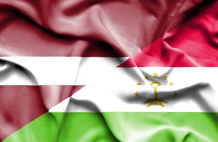 tajikistan: Waving flag of Tajikistan and Latvia Stock Photo