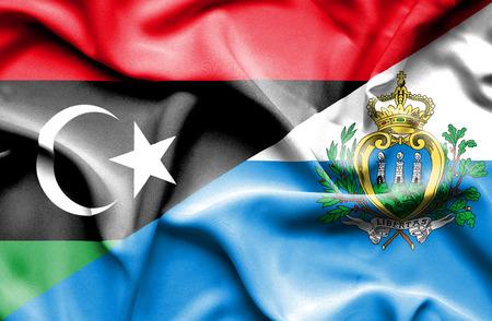 san marino: Waving flag of San Marino and Libya