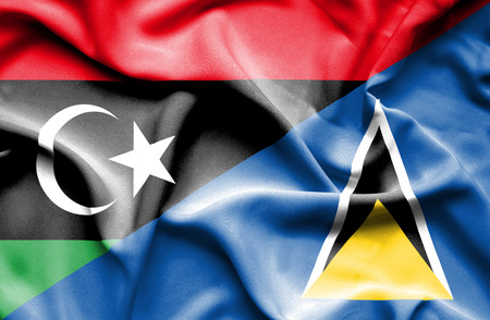 st lucia: Waving flag of St Lucia and Libya Stock Photo