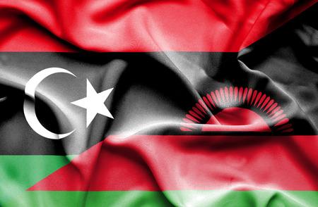 malawian flag: Waving flag of Malawi and Libya Stock Photo