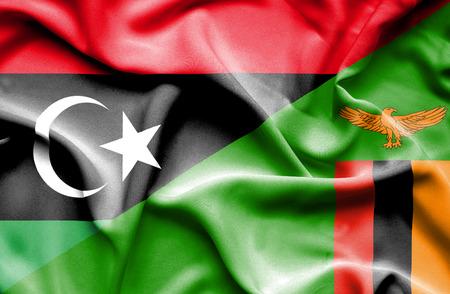zimbabue: Ondeando la bandera de Zimbabwe y Libia