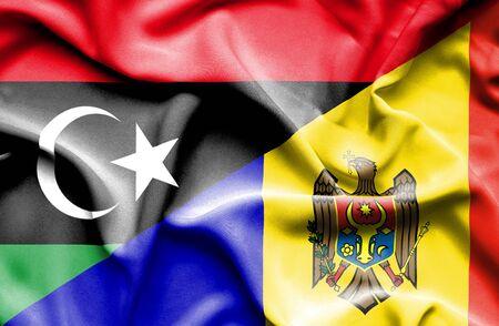 moldavia: Waving flag of Moldavia and Libya
