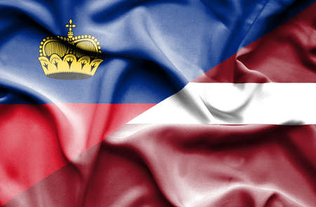 latvia: Waving flag of Latvia and Lichtenstein Stock Photo