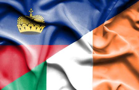 irish history: Waving flag of Ireland and Lichtenstein Stock Photo
