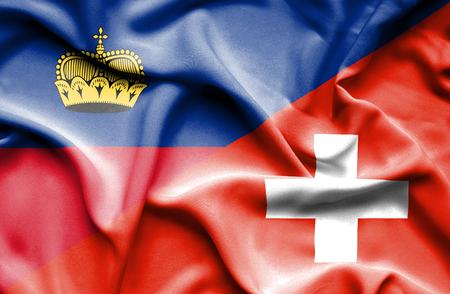 lichtenstein: Waving flag of Switzerland and Lichtenstein Stock Photo