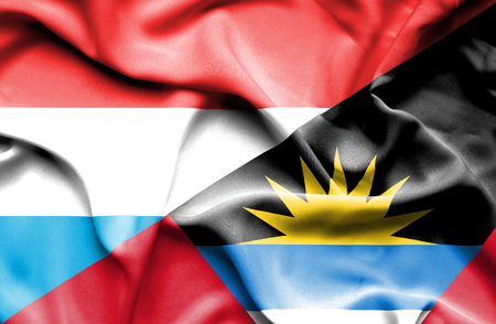 antigua: Waving flag of Antigua and Barbuda and Luxembourg Stock Photo