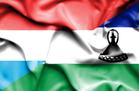 lesotho: Waving flag of Lesotho and Luxembourg Stock Photo