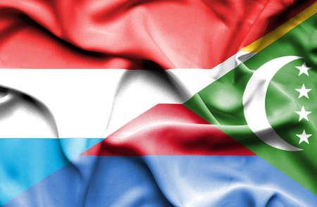 comoros: Waving flag of Comoros and Luxembourg Stock Photo