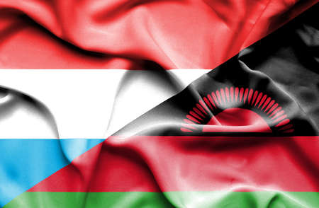 malawian flag: Waving flag of Malawi and Luxembourg Stock Photo