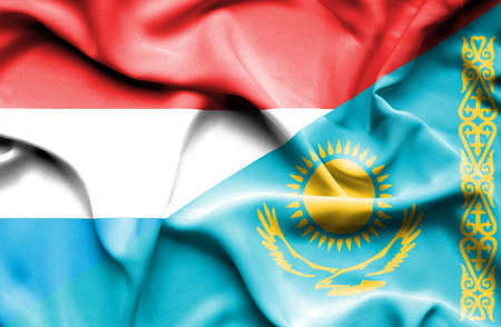 luxembourg: Waving flag of Kazakhstan and Luxembourg Stock Photo
