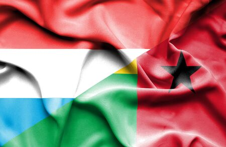 luxembourg: Waving flag of Guinea Bissau and Luxembourg