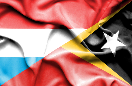 timor: Waving flag of East Timor and Luxembourg Stock Photo
