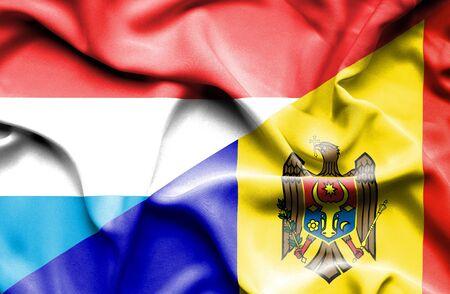 moldavia: Waving flag of Moldavia and Luxembourg Stock Photo