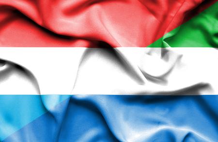 sierra leone: Waving flag of Sierra Leone and Luxembourg
