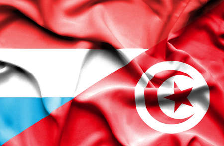 luxembourg: Waving flag of Tunisia and Luxembourg