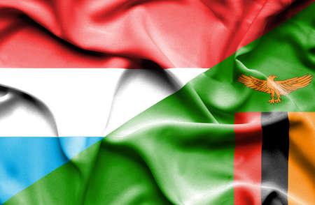 luxembourg: Waving flag of Zimbabwe and Luxembourg Stock Photo