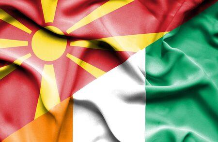 ivory: Waving flag of Ivory Coast and Macedonia Stock Photo