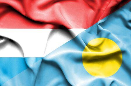 palau: Waving flag of Palau and Luxembourg Stock Photo