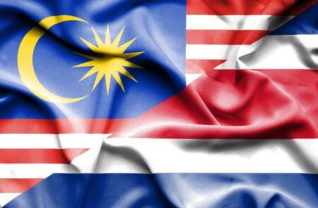 costa: Waving flag of Costa Rica and Malaysia