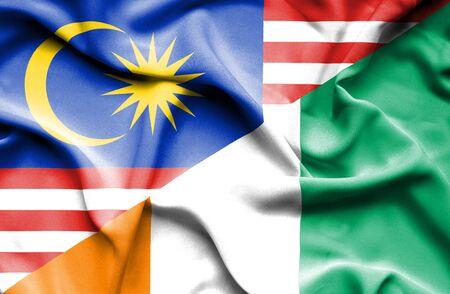 ivory: Waving flag of Ivory Coast and Malaysia Stock Photo