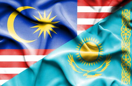 kazakhstan: Waving flag of Kazakhstan and Malaysia Stock Photo