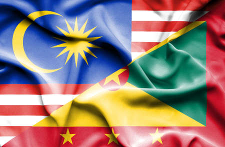 guernsey: Waving flag of Guernsey and Malaysia