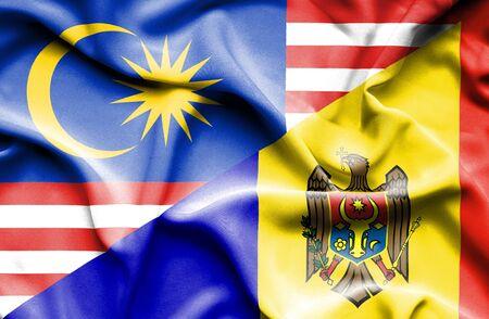 moldavia: Waving flag of Moldavia and Malaysia Stock Photo