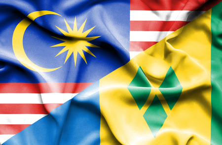 grenadines: Waving flag of Saint Vincent and Grenadines and Malaysia