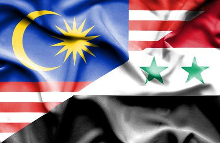 syria peace: Waving flag of Syria and Malaysia Stock Photo