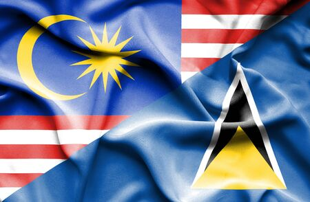 st lucia: Waving flag of St Lucia and Malaysia