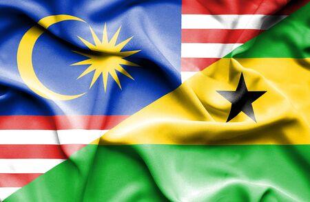 principe: Waving flag of Sao Tome and Principe and Malaysia Foto de archivo