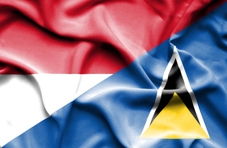 st lucia: Waving flag of St Lucia and Monaco Stock Photo