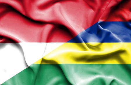 monaco: Waving flag of Mauritius and Monaco Stock Photo