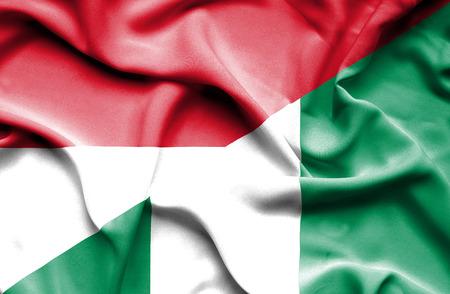 monaco: Waving flag of Nigeria and Monaco Stock Photo