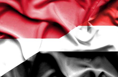 yemen: Waving flag of Yemen and Monaco Stock Photo