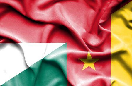 cameroonian: Waving flag of Cameroon and Monaco Stock Photo