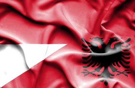 albania: Waving flag of Albania and Monaco Stock Photo