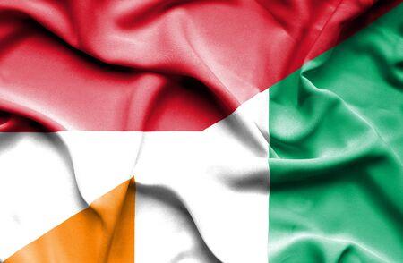 ivory: Waving flag of Ivory Coast and Monaco