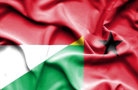 guinea bissau: Waving flag of Guinea Bissau and Monaco