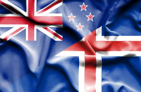 iceland: Waving flag of Iceland and New Zealand Stock Photo