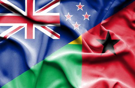 guinea bissau: Waving flag of Guinea Bissau and New Zealand Stock Photo