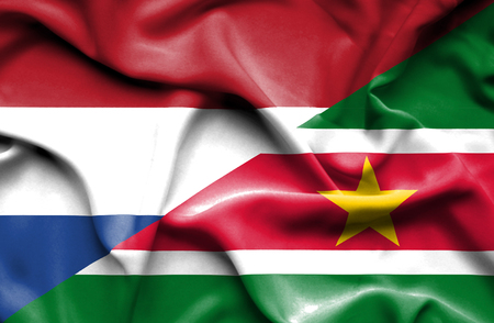 suriname: Waving flag of Suriname and